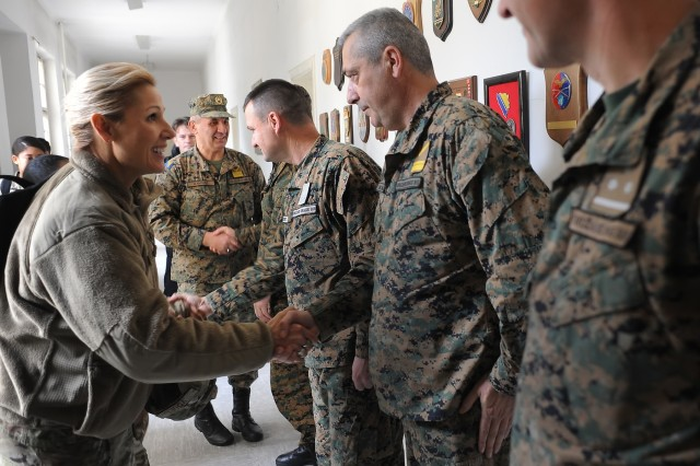 U.S. Air Force Brig. Gen. April Vogel, the Maryland National Guard's assistant adjutant general for Air, meets instructors and staff members of the Bosnia and Herzegovina armed forces' Travnik Training Center in Travnik, Bosnia, Thursday, Nov. 29, 2018. Vogel, along with U.S. Army Brig. Gen. Janeen Birckhead, the Maryland Guard's assistant adjutant general for Army, met with key staff at the center and also spoke to students on the working relationship between officers noncommissioned officers. The Maryland Guard and the Bosnian armed forces are celebrating 15 years of partnership as part of the U.S. Department of Defense's State Partnership Program, which pairs up National Guard elements with partner nations worldwide. Begun in 1993, the program now includes 75 partnerships with 81 countries.
