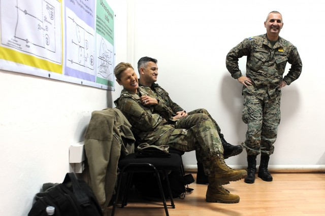 U.S. Air Force Brig. Gen. April Vogel, left, the Maryland National Guard's assistant adjutant general for Air, shares a laugh with instructors from the Bosnia and Herzegovina armed forces' Travnik Training Center during a visit to the center in Travnik, Bosnia, Thursday, Nov. 29, 2018. Vogel, along with U.S. Army Brig. Gen. Janeen Birckhead, the Maryland Guard's assistant adjutant general for Army, met with key staff at the center and also spoke with students on how officers  and noncommissioned officers together form the command team, as well as ways to strengthen that tie. The Maryland Guard and the Bosnian armed forces are celebrating 15 years of partnership as part of the U.S. Department of Defense's State Partnership Program, which pairs up National Guard elements with partner nations worldwide. Begun in 1993, the program now includes 75 partnerships with 81 countries.
