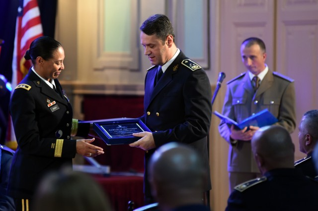 U.S. Army Maj. Gen. Linda Singh, the adjutant general of the Maryland National Guard, accepts an award from Bosnia-Herzegovina army Lt. Gen. Senad Ma�ovi�, chief of the joint staff of the armed forces of Bosnia-Herzegovina, during an event in Sarajevo, Bosnia, commemorating 15 years as partners in the U.S. Department of Defense's State Partnership Program, Tuesday, Nov. 27, 2018. Founded in 1993, the SPP partners National Guard elements with partner nations worldwide and now includes 75 partnerships with 81 nations.