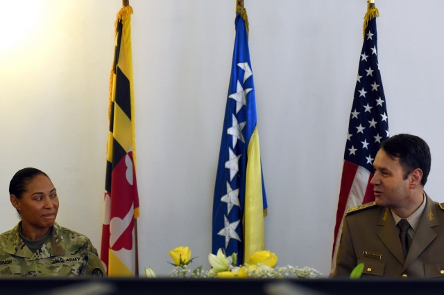 U.S. Army Maj. Gen. Linda Singh, left, the adjutant general of the Maryland National Guard, shares a moment with Bosnia and Herzegovina army Lt. Gen. Senad Ma�ovi�, chief of the joint staff of the armed forces of Bosnia and Herzegovina, during a meeting with Ma�ovi�'s staff  in Sarajevo, Bosnia, Wednesday, Nov. 28, 2018. The Maryland Guard and the Bosnian armed forces are celebrating 15 years of partnership as part of the U.S. Department of Defense's State Partnership Program, which pairs up National Guard elements with partner nations worldwide. Begun in 1993, the program now includes 75 partnerships with 81 countries.