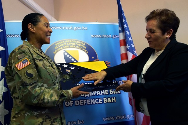 During a meeting in Sarajevo, Bosnia, U.S. Army Maj. Gen. Linda Singh, left, the adjutant general of the Maryland National Guard, presents a gift to Marina Pende�, the Bosnia and Herzegovina minister of defense, commemorating the 15-year partnership between the Maryland Guard and the Bosnia and Herzegovina armed forces as part of the Department of Defense's State Partnership Program, Wednesday, Nov. 28, 2018. The SPP pairs up National Guard elements with partner nations worldwide. Begun in 1993, the program now includes 75 partnerships with 81 countries. The Maryland Guard is partnered with both Bosnia and Herzegovina and Estonia.