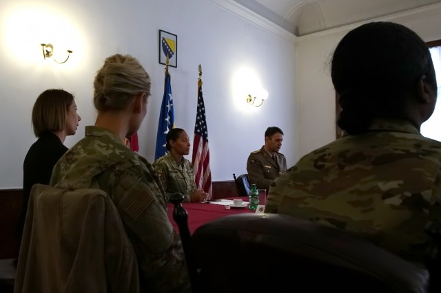 U.S. Army Maj. Gen. Linda Singh, center, the adjutant general of the Maryland National Guard, listens to a briefing from the joint staff of the armed forces of Bosnia and Herzegovina, during a meeting in Sarajevo, Bosnia, Wednesday, Nov. 28, 2018. The Maryland Guard and the Bosnian armed forces are celebrating 15 years of partnership as part of the U.S. Department of Defense's State Partnership Program, which pairs up National Guard elements with partner nations worldwide. Begun in 1993, the program now includes 75 partnerships with 81 countries.