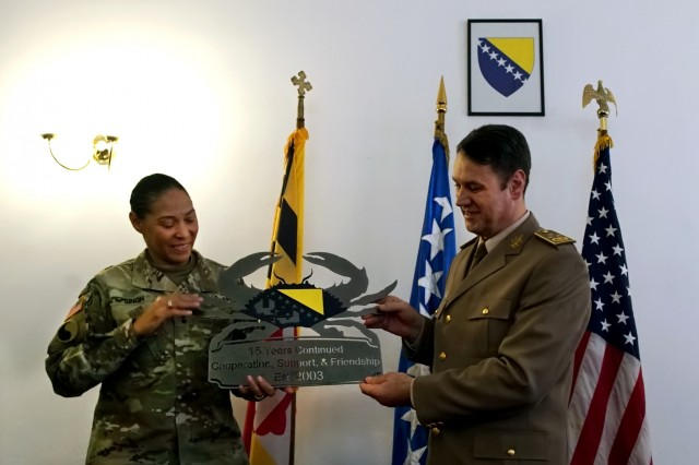 During a meeting in Sarajevo, Bosnia, U.S. Army Maj. Gen. Linda Singh, left, the adjutant general of the Maryland National Guard, presents Bosnia and Herzegovina army Lt. Gen. Senad Ma�ovi�, chief of the joint staff of the armed forces of Bosnia and Herzegovina, a gift commemorating the 15-year partnership between the Maryland Guard and the Bosnia and Herzegovina armed forces as part of the Department of Defense's State Partnership Program, Wednesday, Nov. 28, 2018. The SPP pairs up National Guard elements with partner nations worldwide. Begun in 1993, the program now includes 75 partnerships with 81 countries. The Maryland Guard is partnered with both Bosnia and Herzegovina and Estonia.