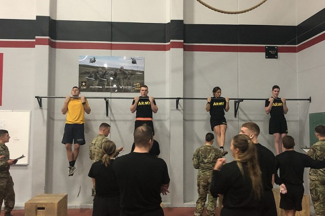 A Sailor and Cadets during the flexed arm hang event at the German Armed Forces Proficiency Badge Competition, hosted by Eastern Washington University ROTC from 17-18 November, 2108.