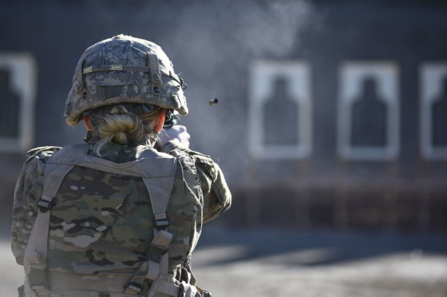 U.S. Air Force Staff Sgt. Jessica Dillow, 92nd Medical Operations Squadron medical technician, performs the marksmanship test during the German Armed Forces Proficiency Badge Competition hosted 17-18 November, 2018 by Eastern Washington University ROTC.
