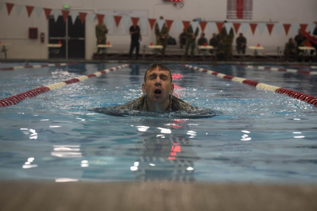U.S. Air Force Staff Sgt. Christopher Munro, 92nd Maintenance Squadron Aerospace Ground Equipment craftsman, performs in the uniformed swim event during the German Armed Forces Proficiency Badge Competition hosted 17-18 November, 2018 by Eastern Washington University ROTC.