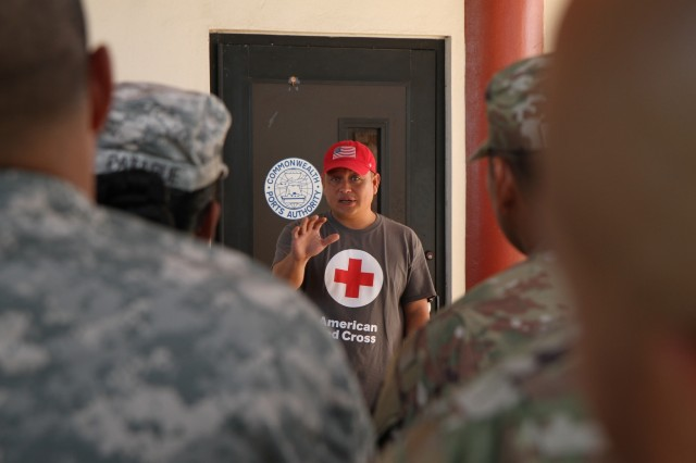 American Red Cross Northern Mariana Islands Chapter Emergency Services Director Juan Diego 'J.D.' Tenorio conveys his appreciations toward U.S. Army Soldiers with the 9th Mission Support Command, U.S. Army Reserve, currently assigned to Joint Task Group-Saipan, Task Force-West, at the Francisco C. Ada International Airport in Saipan, Commonwealth of the Northern Mariana Islands, Nov. 29, 2018. After Super Typhoon Yutu hit the islands of Saipan and Tinian Oct. 24, several federal agencies immediately began a coordinated disaster response effort, including the Federal Emergency Management Agency, Department of Defense and local government, to help the people of these islands recover. DOD forces used in the initial typhoon response have begun redeploying at the direction of FEMA, based on the needs of the local government.