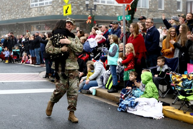 Little Kaylin breaks from the crowd to thank Command Sgt. Maj. Kenneth Graham, command sergeant major for the 20th Chemical, Biological, Radiological, Nuclear, Explosives (CBRNE) Command, for his service with a hug during the 29th Bel Air Christmas Parade. Thousands of people gather every first Sunday in December for the holiday affair, and according to event officials, it grows larger in participation every year.
