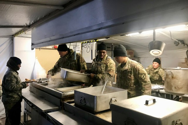 Soldiers assigned to the 593rd Quartermaster Company, 548th Combat Sustainment Support Battalion, 10th Sustainment Brigade, prepare and serve meals in the unit's Containerized Kitchen during Mountain Peak 19-01 on Fort Drum, New York Dec. 3, 2018. The 593rd's field feeding capability provided hot meals for more than 350 Soldiers per day during the field exercise. (U.S. Army photo by Sgt. 1st Class Corey VanDiver, 10th Sustainment Brigade Public Affairs)