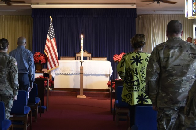 Tripler Army Medical Center staff members attend a hospital memorial service and candlelight vigil to honor President George H.W. Bush, at the Tripler chapel, Dec. 5.