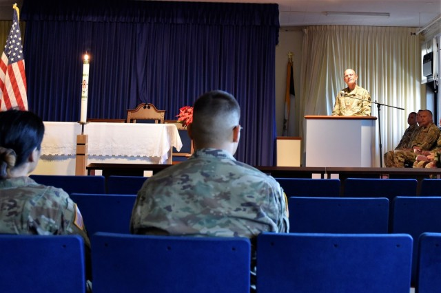 Tripler Army Medical Center staff members listen to Col. (Chaplain) Joseph Fleury from the TAMC Department of Ministry and Pastoral Care during a hospital memorial service and candlelight vigil to honor President George H.W. Bush, at the Tripler chapel, Dec. 5.