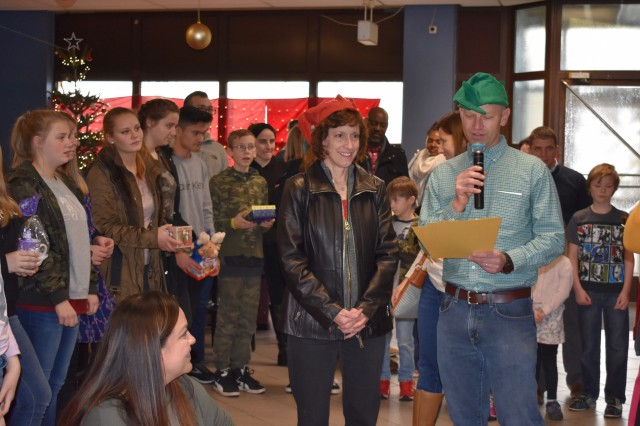 The Ansbach Spouses and Civilians Club, together with the 12th Combat Aviation Brigade (12th CAB), and U.S. Army Garrison Ansbach (USAG Ansbach), invited more than 20 children from the Walburgisheim-Feucht Kinderheim (a children's home) to visit Katterbach Barracks Dec. 1, 2018 for a chance to experience American holiday celebrations and traditions. Children from the home, located about 9 miles south of Nuremberg in the town of Feucht, have been annual guests of the Ansbach community during the holidays for more than 30 years. American families and individual Soldiers acted as sponsors and hosts to the children during their visit.