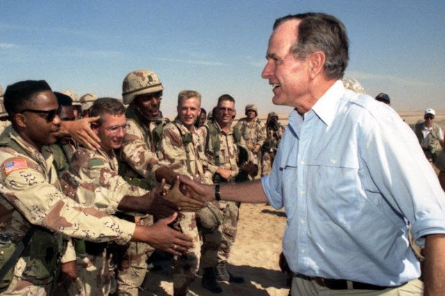 President George H.W. Bush meets with troops in Saudi Arabia on Thanksgiving during the Gulf War, Nov. 22, 1990.