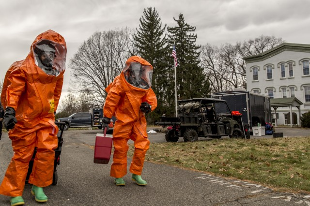 U.S. Army Staff Sgt. Kristin Northrup, a survey team chief, and Spc. Sean Murray, a survey team member, assigned to the 2nd Weapons of Mass Destruction Civil Support Team (CST), New York National Guard, move to inspect, scan and catalog the contents of a simulated bomb maker's vehicle during a hazardous materials exercise with the City of Kingston Fire Department in Kingston, N.Y., Nov. 28, 2018. The 2nd CST, based in Scotia, N.Y., is trained to identify and respond to chemical, biological, and radiological agents and advise first-responders on how to deal with those threats.