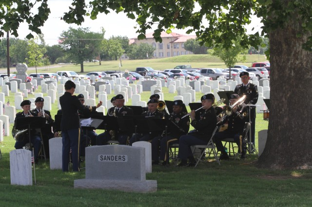 Chief Warrant Officer 2 Bridgette Brenmark conducts the 77th Army Band during a ceremony at Fort Sill earlier in 2018.