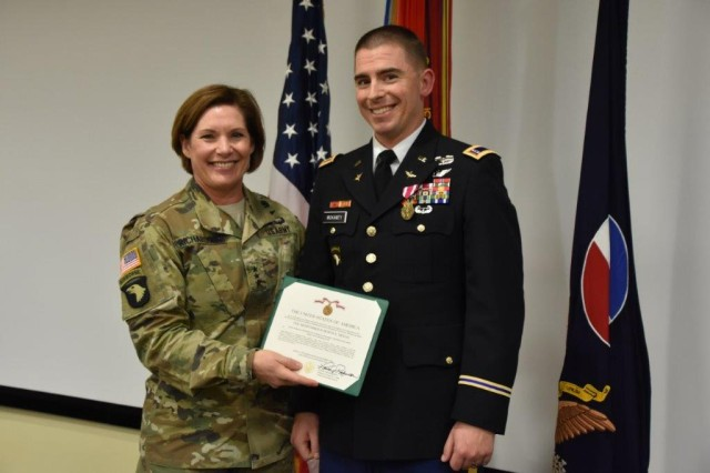 LTG Laura Richardson, acting Commanding General of Us. Army Forces Command, presents CW2 Sam McKarney with an Army Meritorious Service Medal as the winner of the FORSCOM General Douglas McArthur Leadership Award. CW2 McKarney will represent FORSCOM at the Headquarters Department of the Army competition announced in spring of 2019.