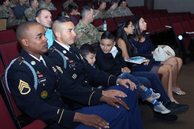 Drill sergeants (Staff Sgts.) Danny Gardner and Gilbert Mayer await the opening introductions of the quarterly Sgt. Audie Murphy Club inductee ceremony Nov. 27, 2018, at Snow Hall on Fort Sill, Okla.