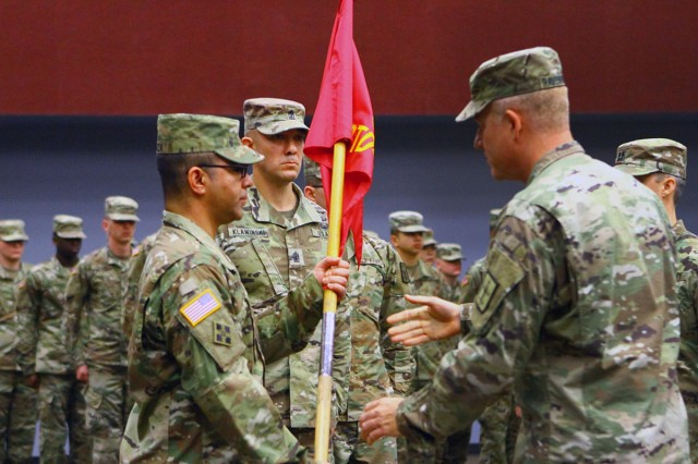 Maj. Carlos G. Arriaza (left) receives the Ordnance Training Detachment - Sill colors from Lt. Col. H. Russell Ravenhorst to become the new commander of OTD-S Nov. 30, 2018, at Fort Sill. Arriaza was most recently as Osan Air Base, Korea.