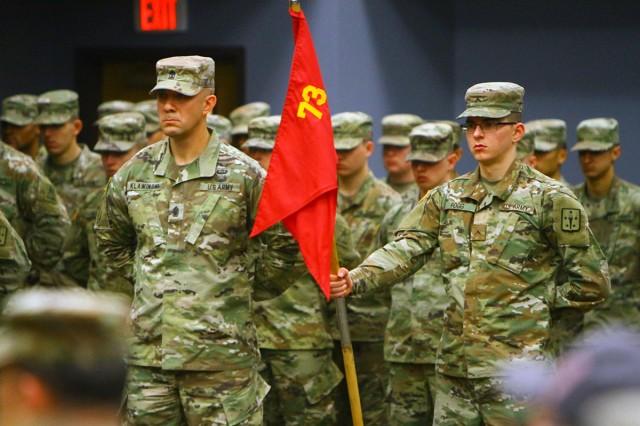 1st Sgt. Matthew Klawinski and guidon bearer Pvt. Noah Fogg listen to a speaker during the Ordnance Training Detachment - Sill change of command ceremony Nov. 30, 2018.
