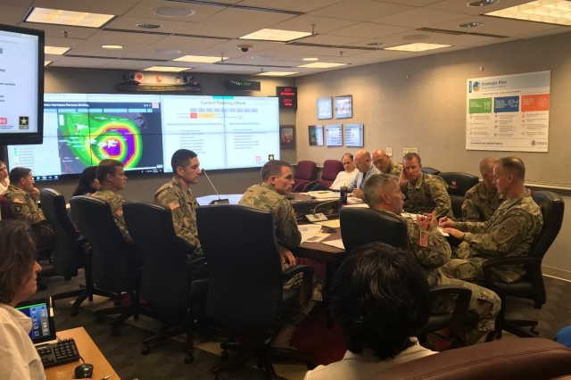 Lt. Gen. Todd T. Semonite, 54th U.S. Army Chief of Engineers and Commanding General of the U.S. Army Corps of Engineers, and senior leaders closely monitor Hurricane Florence in Washington D.C.  On the left screen is the South Atlantic Division viewer produced by the GIS team supporting Hurricane Florence Response.