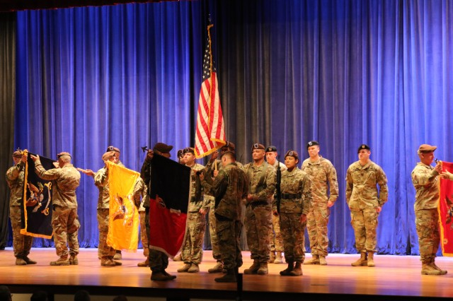 Brig. Gen. Scott Jackson, 1st Security Force Assistance Brigade commander, and Command Sgt. Maj. Christopher Gunn, uncase the 1st SFAB colors on Dec. 3 in Marshall Auditorium at Fort Benning, Ga. The uncasing ceremony signifies the completion of the unit's 9-month deployment conducting train, advise, assist, enable and accompany operations for the NATO Resolute Support Mission's Train, Advise, Assist Commands and Task Forces. (U.S. Army photo by Sgt. 1st Class Mark Albright, Security Force Assistance Command Public Affairs)
