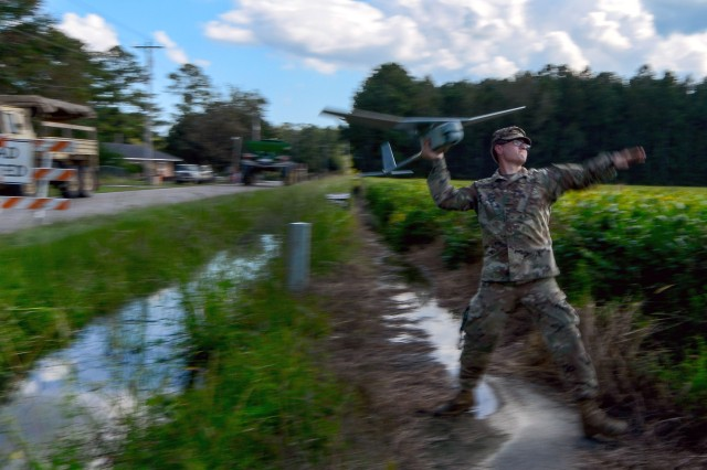 Army Pfc. Michael Makowski, with the South Carolina Army National Guard's D Company, 1st Battalion, 118th Infantry Regiment, launches an RQ-11B Raven in Bucksport, South Carolina, during Hurricane Florence response operations, Sept. 26, 2018. The unmanned aircraft system assists Army Guard units in gathering situational awareness of disaster scenes and sharing that information with other Guard elements, emergency officials and first responders.