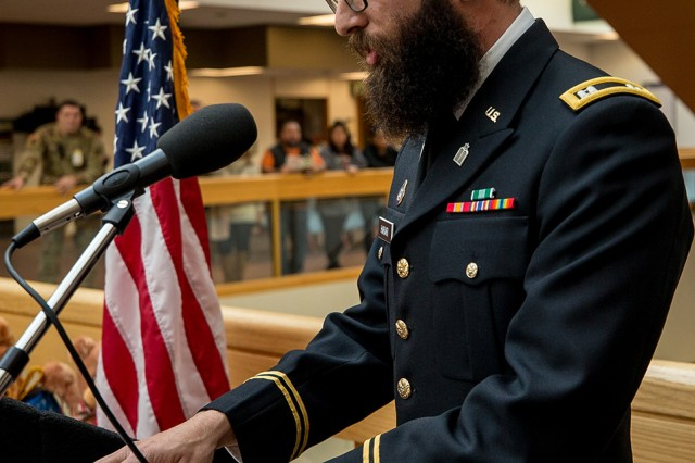 Chaplain (Capt.) Michael Harari discusses the history and meaning of the menorah at a Christmas tree and menorah lighting ceremony at Madigan Army Medical Center on Nov. 30.