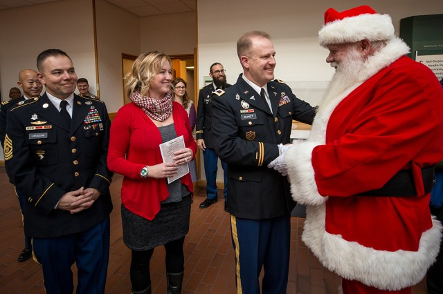 Madigan Army Medical Center's Command Sgt. Maj. Victor Laragione, his wife, Crystal and Commander Col. Thomas Bundt meet Santa at a Christmas tree and menorah lighting ceremony on Nov. 30.