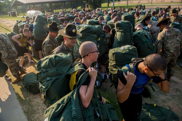 FORT BENNING, Ga. (July 13, 2018) - Initial entry trainees arrive at Echo Company, 2nd Battalion, 19th Infantry Regiment, on Fort Benning, Georgia, July 13, 2018, for the first day of the 22-week pilot program for One Station Unit Training for Infantry Soldiers. The new OSUT program included expanded weapons training, increased vehicle-platform familiarization, extensive combatives training, a 40-hour combat-lifesaver certification course, increased time in the field during both day and night operations and increased emphasis on drill and ceremony maneuvers. (U.S. Army photo by Patrick A. Albright, Fort Benning Maneuver Center of Excellence photographer)