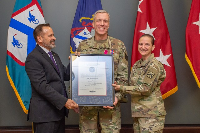 Brig. Gen. Scott L. Efflandt, provost of the Army University, receives the Army University Star from Allen Borgardts, deputy provost, and Command Sgt. Maj. Teresa Duncan in recognition of his service to Army University.