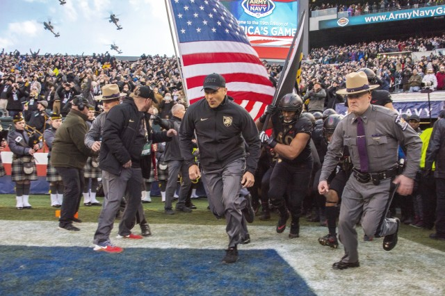 Army Black Knights football coach Jeff Monken leads the team onto the field for the Army-Navy game in Philadelphia, Dec. 8, 2018. Army won 17-10 for its third straight win over their archrival.
