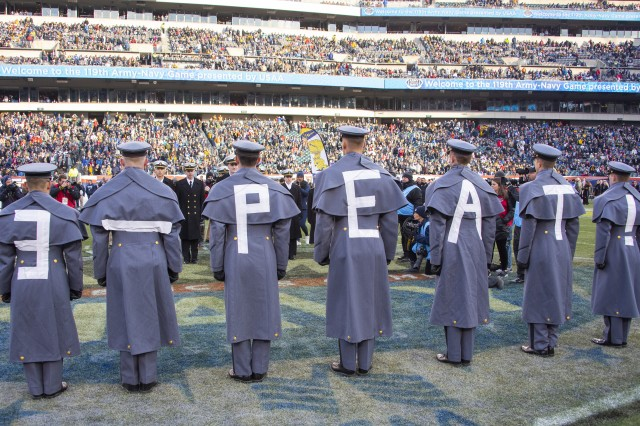 "U.S. Military Academy cadets wear ""3-Peat!"" on the backs of their uniforms during a prisoner exchange before the Army-Navy game in Philadelphia, Dec. 8, 2018. Army won 17-10 for its third straight win over their archrival. Some cadets and Navy Midshipmen take courses in their counterpart's academy and are released to their respective academy for the game."