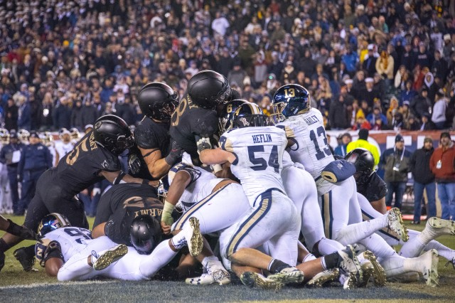 Army quarterback Kelvin Hopkins, center, scores the final touchdown of the Army-Navy game in Philadelphia, Dec. 8, 2018. Army won 17-10 for its third straight win over their archrival.