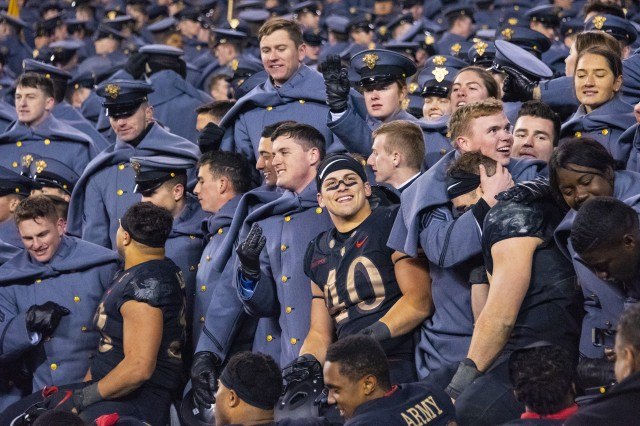 Army football players jump into the stands to celebrate with fellow cadets after the Army-Navy game in Philadelphia, Dec. 8, 2018. Army won 17-10 for its third straight win over their archrival.