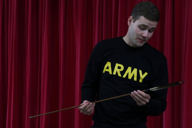 Spc. Nicholas Demetropoulos of the Utah National Guard examines an arrow on display at the icebreaker event leading to the start of Yama Sakaura 75 at Camp Higashi Chitose, Japan, Dec 6, 2018. Soldiers from America's First Corps, the 593rd Expeditionary Sustainment Command and other units joined the Northern Japan Army in a social event that included cultural activities and a display of traditional Japanese clothing and artifacts before the kickoff of the joint training exercise Yama Sakura. Yama Sakura, which means mountain cherry blossom, is a bilateral command post exercise with the Japan Ground Self-Defense Force in which U.S. and Japanese forces exchange ideas, techniques, military experience and exercise capabilities in defense of Japan. The exercise underscores the strength of the close, long-standing relationship the United States has with Japan and the JGSDF. U.S. Army photo by Sgt. Erica Earl