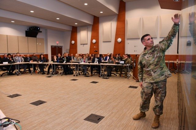 CAMP HUMPHREYS, Republic of Korea - Col. Andrew Morgado, native of Danbury, Connecticut, chief of staff, 2nd Infantry Division/ROK-U.S. Combined Division, briefs DOD Executive Leader Development Program (ELDP) class of 2019 about the division's mission philosophy and organizational structure at Freeman Hall Dec. 4. He explained the 2ID/RUCD mission as the only combined division in the Army with ROK soldiers actively serving side-by-side in the unit. (U.S. Army Photo by Mr. Pak, Chin U., 2ID/RUCD Public Affairs)