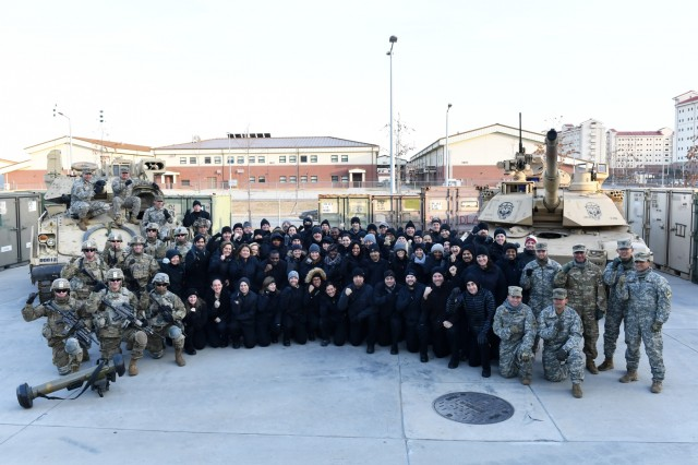 "CAMP HUMPHREYS, Republic of Korea - Tankers and infantrymen with 1st Battalion, 67th Armored Regiment, 3rd Armored Brigade Combat Team, 1st Armored Division, a rotational unit under 2nd Infantry Division/ROK-U.S. Combined Division, pose for a group photo with the DOD Executive Leader Development Program (ELDP) class of 2019 Dec. 7. The Fort Bliss, Texas-based ""Bulldog"" brigade Soldiers showcased the M1 Abrams Main Battle Tank and M2 Bradley Fighting Vehicle and infantry tactics employed in an armored BCT to give the ELDP class an idea of the unit's combat power. (U.S. Army Photo by Mr. Pak, Chin U., 2ID/RUCD Public Affairs)"