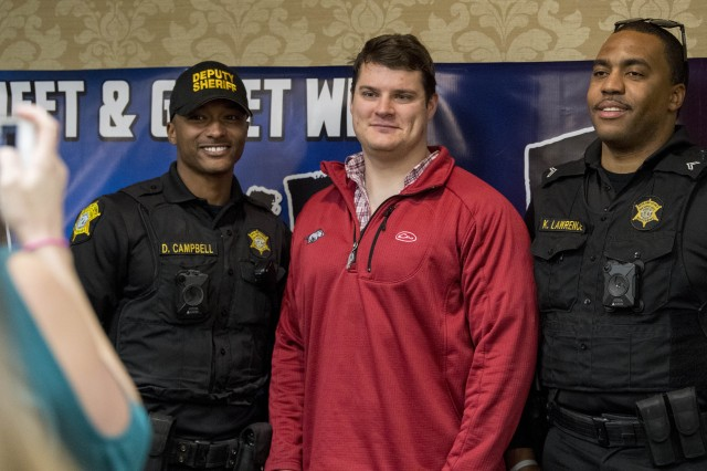 "Deputy DonnyRay Campbell and Investigator Kevin ""K-LAW"" Lawrence, of the Richland County Sheriff's Department, meet a fan during a Nov. 29 appearance on post. Both are among the deputies followed by the A&E television series 'Live PD.'"