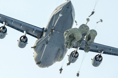 Paratroopers jump from an Air Force C-17 Globemaster III with the 517th Airlift Squadron during airborne training over Malemute drop zone, Joint Base Elmendorf-Richardson, Alaska, Jan. 9, 2018. The Soldiers of assigned to the 4th Infantry Brigade Combat Team (Airborne), 25th Infantry Division, belong to the only American airborne brigade in the Pacific and are trained to execute airborne maneuvers in extreme cold weather/high altitude environments in support of combat, training and disaster relief operations.