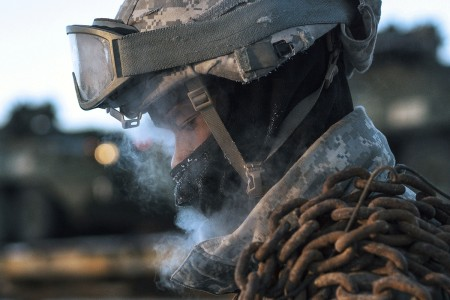 A Soldier assists with railhead operations in subzero temperatures at Joint Base Elmendorf-Richardson, Alaska, Jan. 30, 2018, as part of Arctic Thrust, a short-notice rapid deployment exercise.