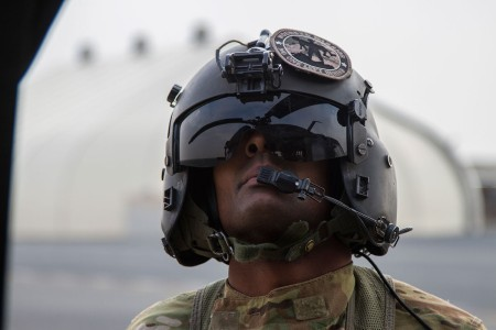 A crew chief with the Louisiana National Guard preforms preflight inspection of a UH-60M Black Hawk at Camp Buehring, Kuwait, Feb. 27, 2018.