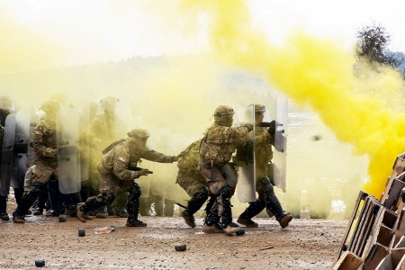 Soldiers with 2nd Infantry Brigade Combat Team, 4th Infantry Division, prepare to move a barricade during riot control training in preparation for an impending deployment to Kosovo at the Joint Multinational Readiness Center's Hohenfels Training Area, Germany, March 6, 2018. The Kosovo Force is a NATO-led international peacekeeping force, which is responsible for establishing and maintaining a secure environment in Kosovo.