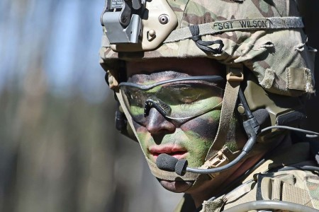 A paratrooper with the 173rd Airborne Brigade, communicates via radio during a platoon level live-fire exercise at Grafenwoehr Training Area, Germany, March 19, 2018.