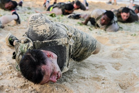U.S. Army Soldiers of the Special Forces Basic Combat Course endure a morning physical fitness training session at Torii Station, Okinawa, Japan, April 15th, 2018. Soldiers participating in SFBCC will receive rigorous training for 2 weeks, in order to educate students on Special Forces tactics, training and skills.