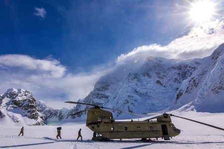 Soldiers and National Park Service personnel unload items from the CH-47F Chinook helicopters, April 22, 2018. Aviators from 1st Battalion, 52nd Aviation Regiment provided an assist to the National Park Service by flying thousands of pounds of equipment and supplies from Talkeetna to the NPS base camp at the 7,000-foot level of the Kahiltna Glacier in preparation for the 2018 Denali climbing season.