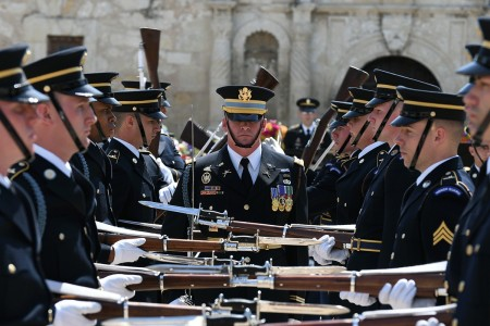 The U.S. Army Drill Team display discipline through unified movement in formation and shocking catches of bayonet-tipped 1903 Springfield Rifles, April 24, 2018, during Army Day at the Alamo in San Antonio, Texas.
