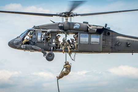A Soldier exits a Black Hawk helicopter via a rope during a demonstration at the 6th Ranger Training Battalion's open house event, May 5, 2018, at Eglin Air Force Base, Fla. The event was a chance for the public to learn how Rangers train and operate.