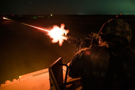 U.S. Army Reserve military police fires an M240B Machine Gun mounted on a Humvee turret during a night fire qualification at Fort Riley, Kan., May 17, 2018. The 346th Military Police Company hosted and conducted a 3-week gunnery training and range for approximately 30 vehicle crews to qualify day and night on crew serve weapons.