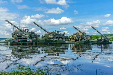 Elements of the 2nd Cavalry Regiment aboard German M3 Amphibious Bridging Vehicles cross the Nemen River River near Kulautuva, Lithuania, during Saber Strike 18, June 13, 2018. Saber Strike is an annual multinational exercise currently in its eighth year that helps participating militaries maintain readiness and interoperability.