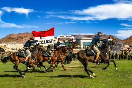 The 11th Armored Cavalry Regiment's Horse Detachment, conducts the ceremonial Last Charge as a farewell to the outgoing commander during a change of command ceremony on Fort Irwin, Calif., June 28, 2018.